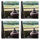MSD Natural Rubber Square Coasters IMAGE ID: 35004468 Vintage jar filled with water and the natural background of farmland