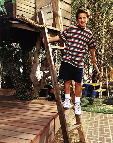 Ben Savage standing on a Wood Ladder in Striped Black T-Shirt and Black Basketball Short with White Rubber Shoes Photo Print (24 x 30) ()