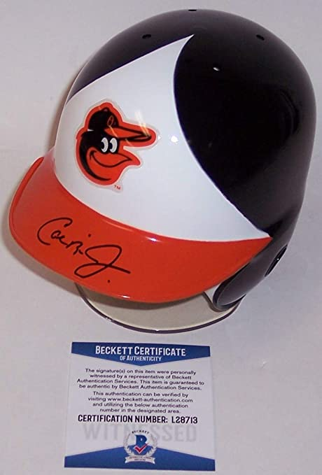076ff4ce7 Amazon.com  Cal Ripken Jr. Autographed Hand Signed Baltimore Orioles Mini  Batting Helmet - BAS Beckett  Sports Collectibles