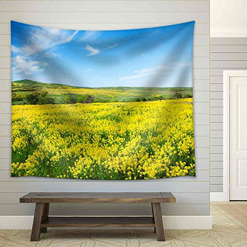Green Field with Flowers Under Blue Cloudy Sky Fabric Wall