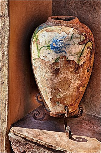 Photograph of Southwest pottery vase with painted blue flowers on an Arizona windowsill. Great (Painted Pottery Vase)