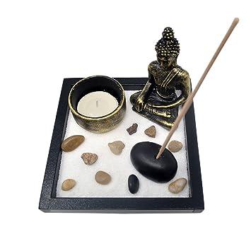 Garten mit Buddhafigur Ganesha Teelicht  Räucherstäbchen Zen