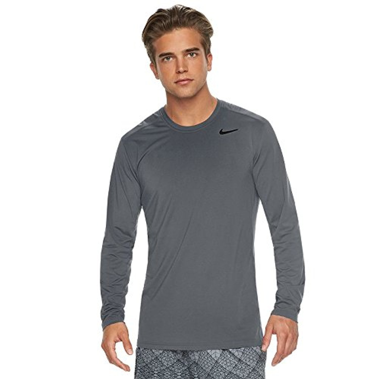 b4eb56bcb353 Nike Dry fabric with Dri-FIT technology helps you stay dry and comfortable.  Fitted design for comfortable workouts. Seams are rolled forward
