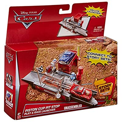 Disney/Pixar Cars Story Sets Piston Cup Pit Stop Play & Race Launcher: Toys & Games