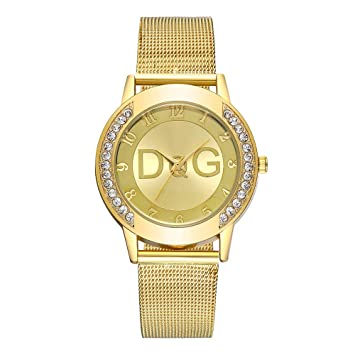 2159e7c7452d Amazon.com   NXDA Simple fashion wrist watch ladies stainless steel strap  watch rhinestone case solid color strap (Gold)   Beauty