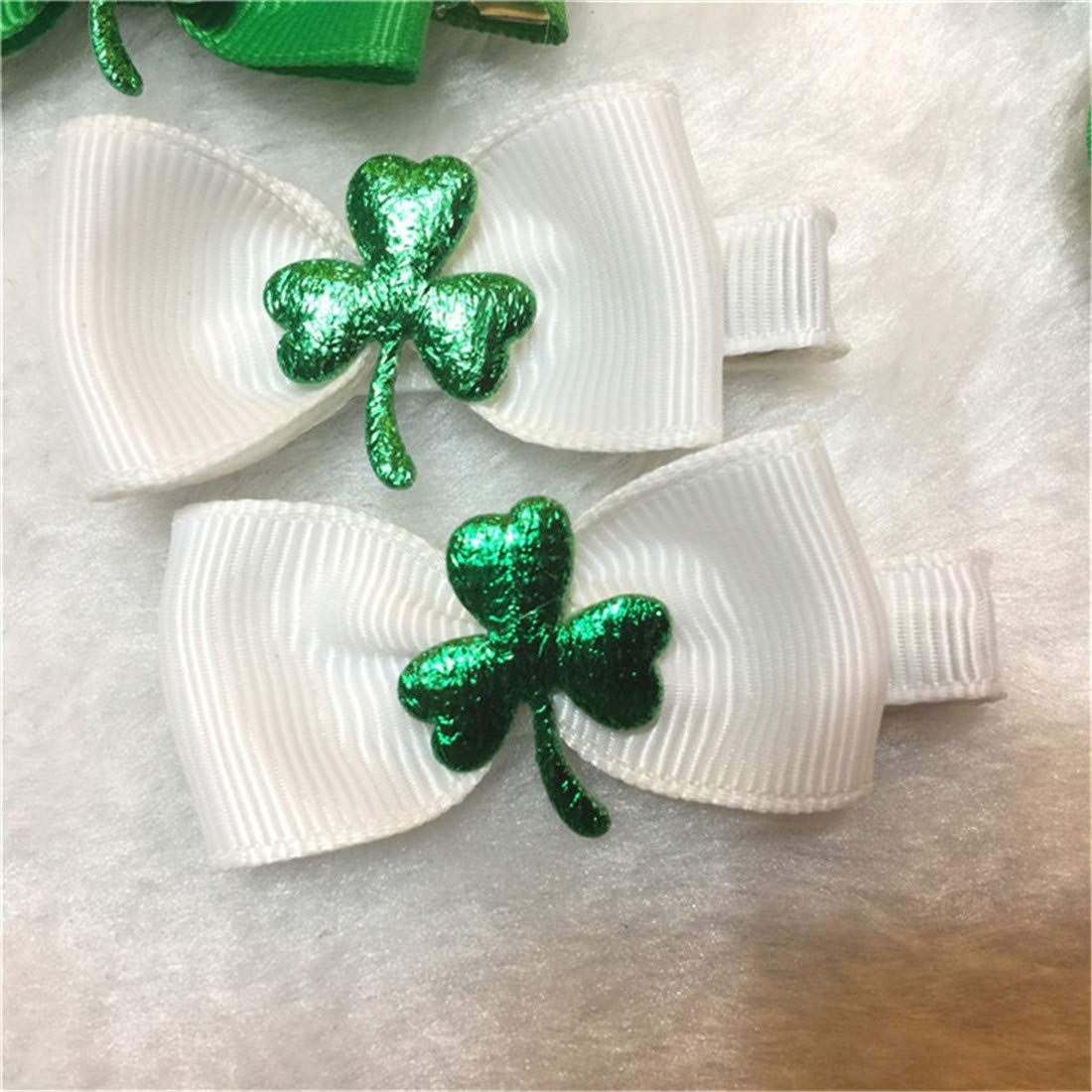 St patty day. Stacked pinwheel hair bow St patricks day ribbon hairbow with clay center Bow is attached to alligator clip with teeth
