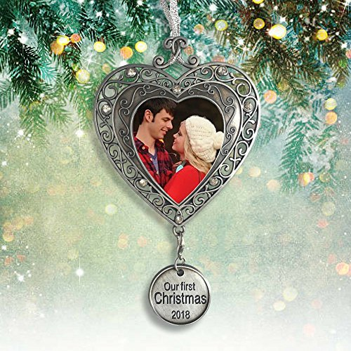 - Banberry Designs Our First Christmas Ornament 2018 - Silver Filigree Heart Shaped Photo Ornament with a Hanging Charm that Reads Our First Christmas 2018