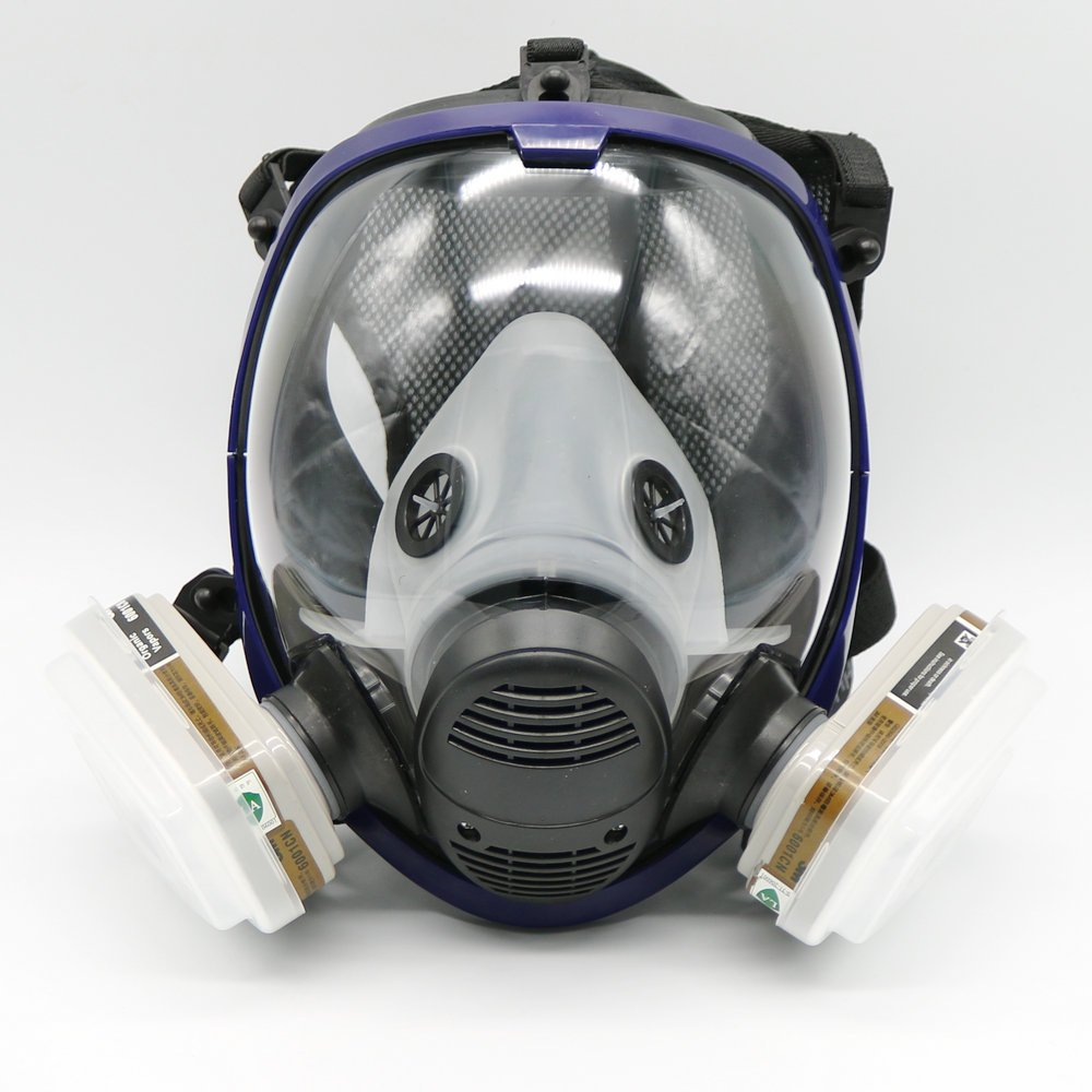 Traje para pulverización de pintura de piezas a una máscara de gas