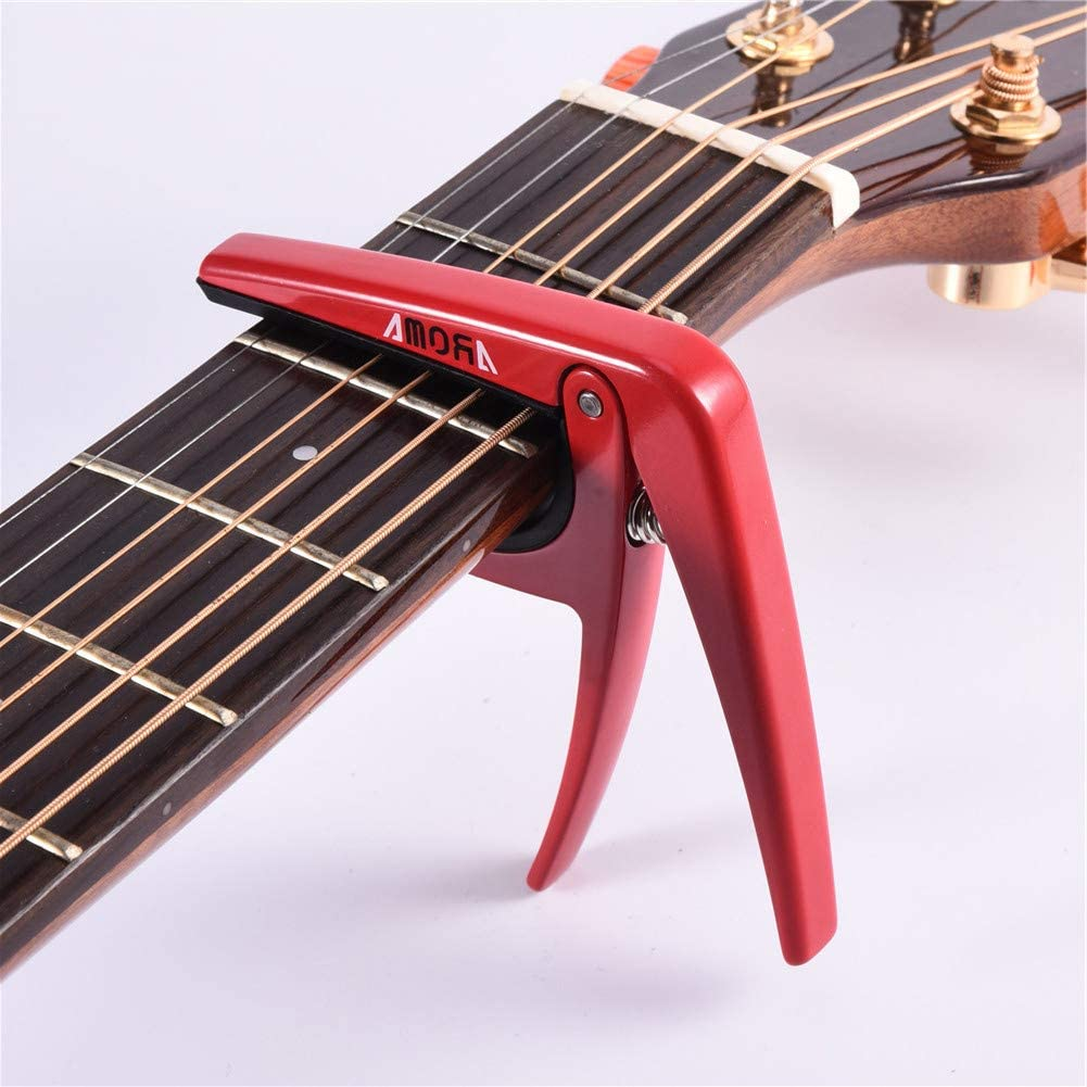Red acoustic electric guitar capo
