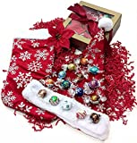 Makes the perfect gift for almost anyone... the Lindt Lindor truffles collection is perfect for chocolate connoisseurs! Also includes Santa Claus style Christmas hat and coordinating Christmas stocking with a poinsettia floral pick accent. Ar...