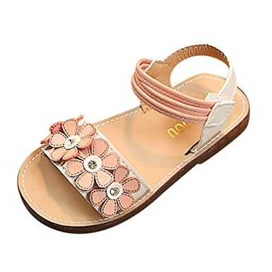a9a03a79f6dac2 Amazon.com  Axinke Toddlers Little Girls Open Toe Non-Slip Casual Flat  Princess Shoes Roman Sandals with Flowers  Clothing