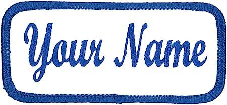 A white work shirt patch that says Scott in light blue script with light blue border. Scott