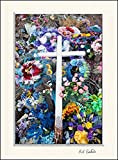 11 x 14 inch mat including wall art photograph of a discarded wooden white cross from a graveyard along with colorful flower memorial wreaths.