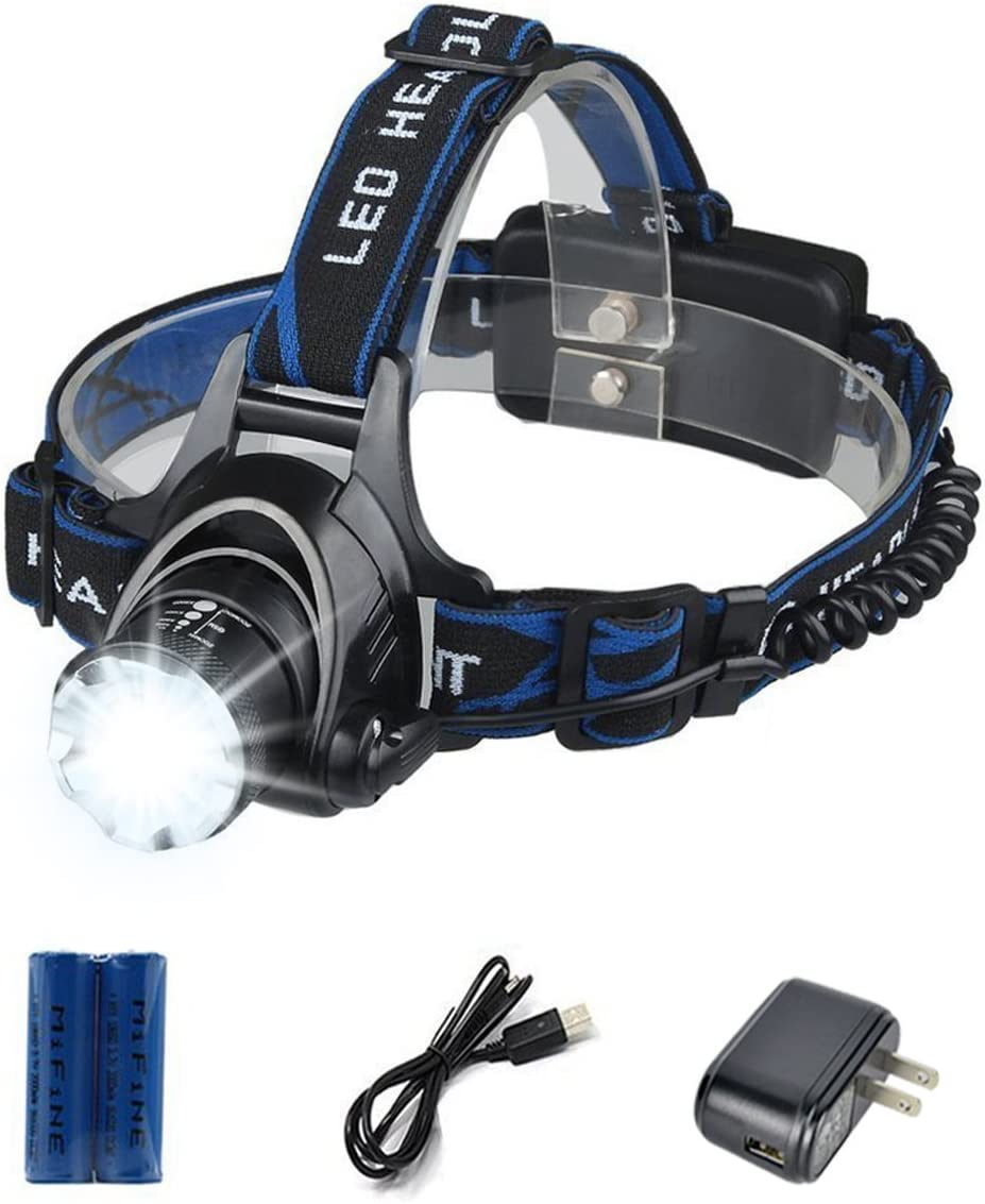 Image of a headlamp with beam on, with batteries, USB charger below it. black and blue colored headband.