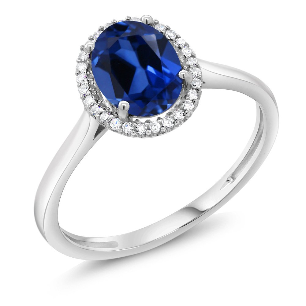 10K White Gold Diamond Halo Engagement Ring set with 1.60 Ct Oval Blue Simulated Sapphire (Ring Size 6)