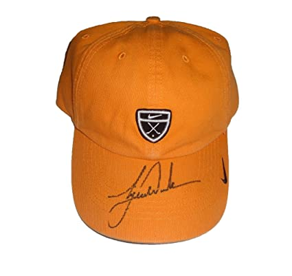 purchase cheap d0a60 c73bb Tiger Woods Autographed Orange Nike Hat W PROOF, Picture of Tiger Signing  For Us