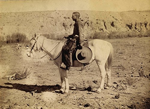 Southwestern Cowboy Wearing Buffalo Chaps And Armed With A Pearl Or Ivory-Gripped Colt Model 1878 Double Action Frontier Revolver Ed W Ecker Semi-Arid Desert Landscape Holding A Wide-Brim Hat By His