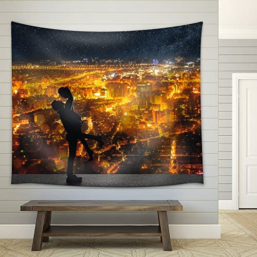 Silhouette of Asian Couple Man Hold His Girlfriend Up Above The City in Night Under Stars Fabric Wall
