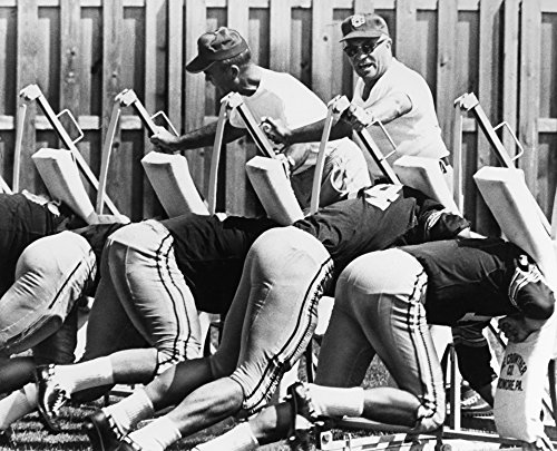 Vince Lombardi (1913-1970) Namerican Football Coach As Head Coach Of The Green Bay Packers Urging His Players On As They Practice On A Blocking Sled At The TeamS Training Camp In Green Bay Wisconsin 1
