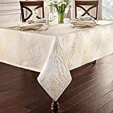 Linens Timber 70-Inch x 126-Inch Oblong Tablecloth in Gold/Silver, metallic trees printed over a woven jacquard textile create a luxurious ambiance among your fine china and glasses!