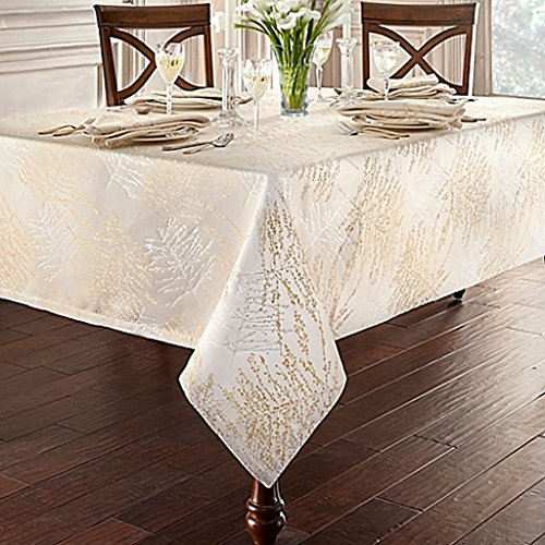 Linens Timber 70-Inch x 126-Inch Oblong Tablecloth in Gold/Silver, metallic trees printed over a woven jacquard textile create a luxurious ambiance among your fine china and glasses! by Waterford