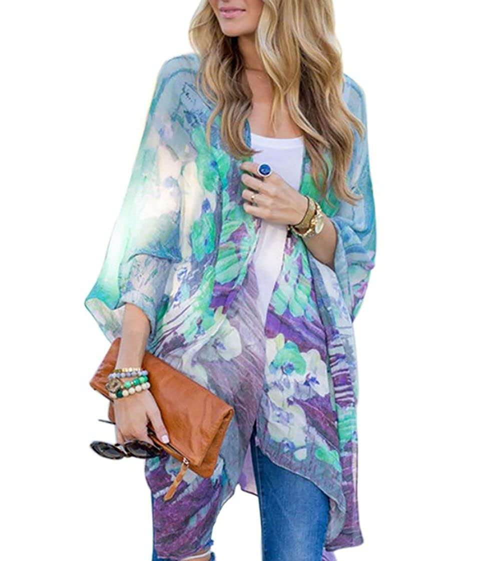 9b1d1b5c5a Lightweight chiffon boasts a drape with an allover prints design. Long  kimono with floral or geo pattern. Open draped front. Long flutter sleeves.
