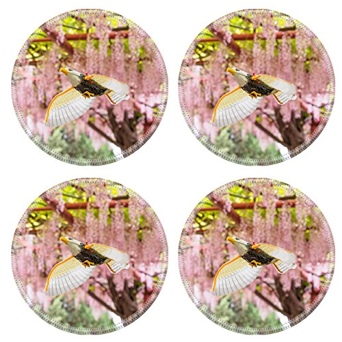 (MSD Round Coasters Non-Slip Natural Rubber Desk Coasters design: 27966602 A bird toy flying on the background of pink wisteria)