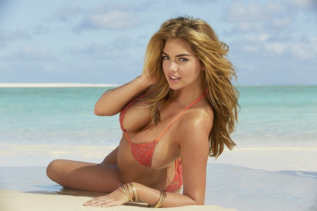 Kate Upton sexy picture #1, Laying on a beach, wearing a string bikini