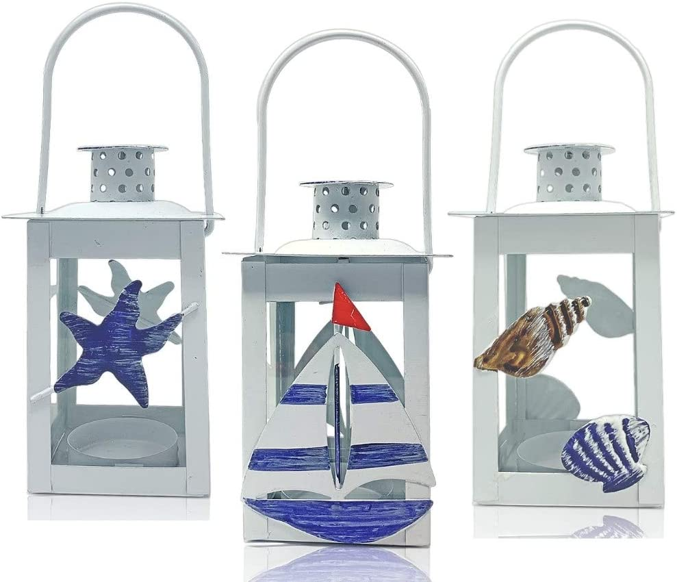 BANBERRY DESIGNS Beach Lantern Set - 3 Decorative Nautical Metal Lanterns Coastal Decorations for Home - Sailboat Starfish and Seashell Designs - White and Blue Accents - 7 Inches Tall