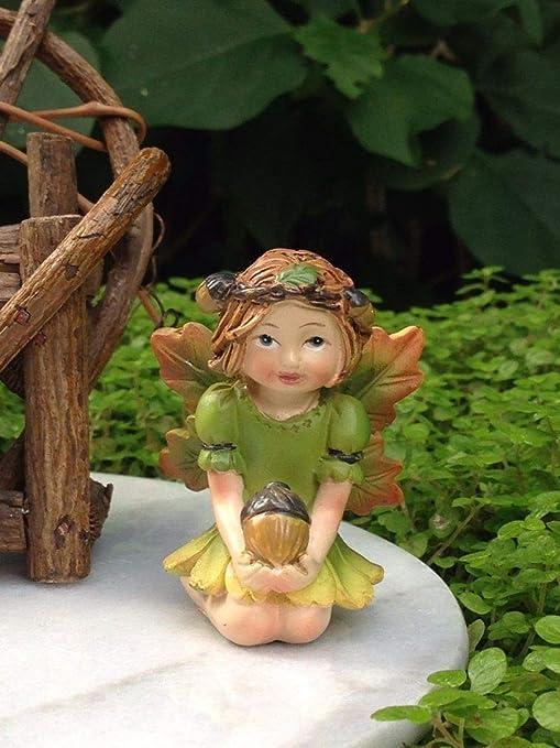 Miniatura jardín de hadas ~ Halloween Fall Acción de Gracias hada niña figura de bellota con bellota: Amazon.es: Juguetes y juegos