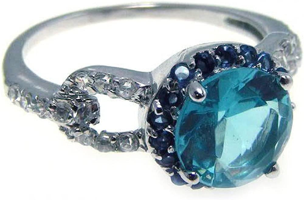 Blue Center Cluster And Clear Cubic Zirconia Ring Rhodium Plated Sterling Silver