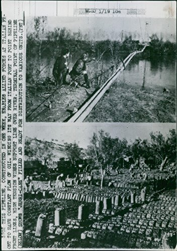 (Vintage photo of This pipeline, constructed in one week, enables allied forces at Italian front to have constant flow of oil. Winding its way from Italian port to point behind front lines. High tension wires support line over river. Terminal point of pipeline (below) shows