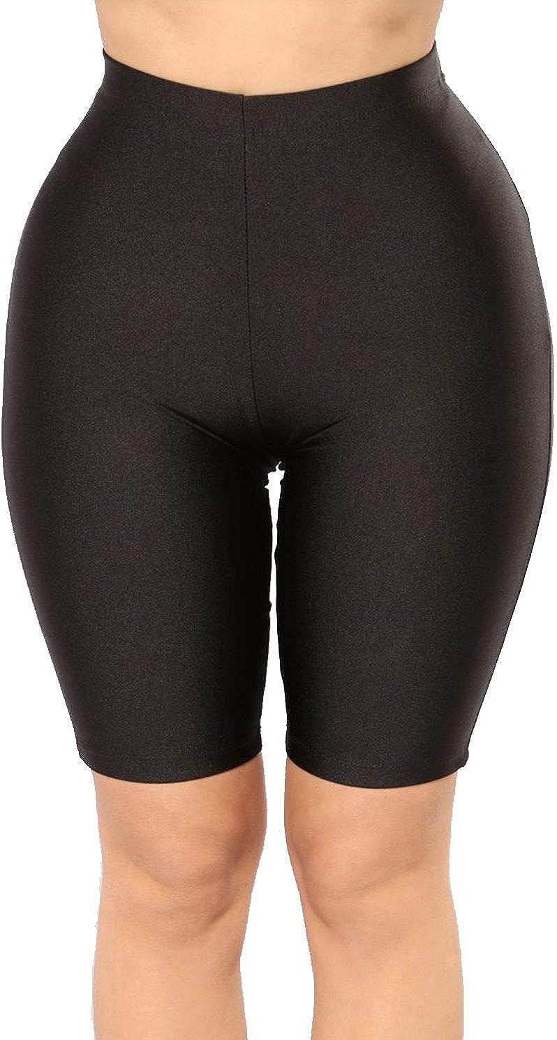 Neon yellow shiny spandex shorts hot pants
