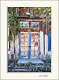 11 x 14 inch mat including a wall art photograph of a well worn wooden blue door with reflecting window panes. This distressed abandoned garden New Mexico ghost town home image makes a great gift.