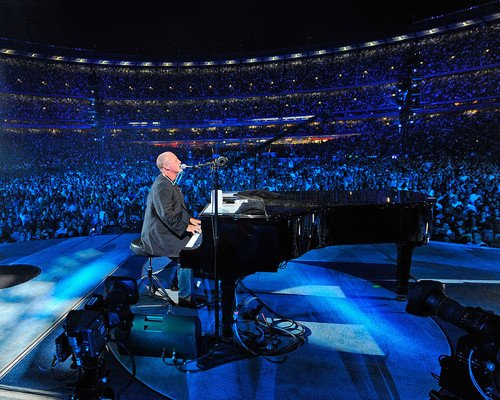 Billy Joel playing piano on stage with audience surrounding concert 8x10 Promotional -