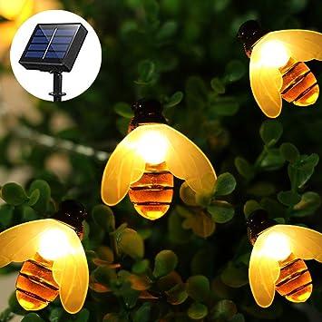 Guirnaldas Luces exterior Solar, Impermeable cadena luces de Abeja en 20 LED 3.5 Metro, cadena luz decorativa de hadas para exteriores, jardines, patios, bodas, fiestas (blanco cálido): Amazon.es: Electrónica