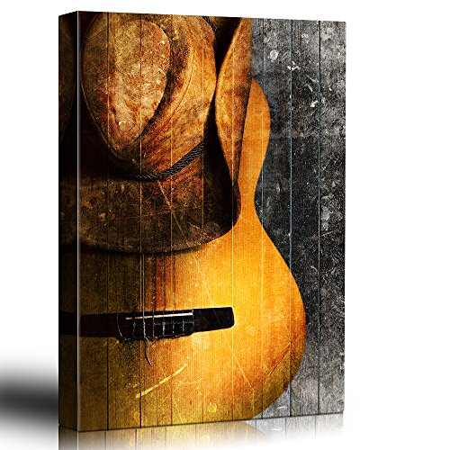 Guitar and cowboy hat on rustic wood Weathered hat rests on an acoustic guitar Painted wood texture country style