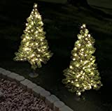 Set of 4, Pre-Lit 2' Tall Artificial Pathway Christmas Trees for Indoor/Outdoor use. Includes 50 warm white led lights, steel ground stake