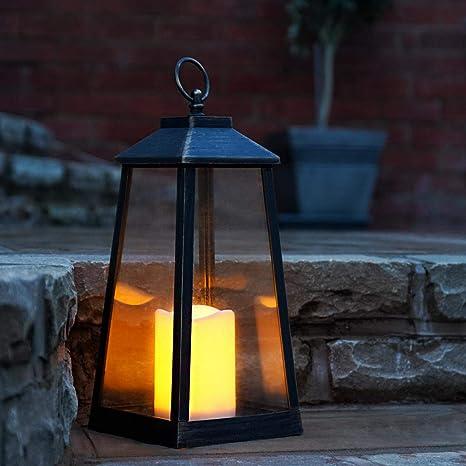 Festive Lights Lanterna Con Finta Candela Da Esterni Per Giardino Alimentata A Batteria Luce Led Bianco Caldo Effetto Tremolante 33 Cm Colore Bronzo Amazon It Giardino E Giardinaggio