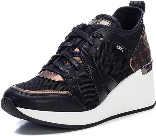 xti black trainers