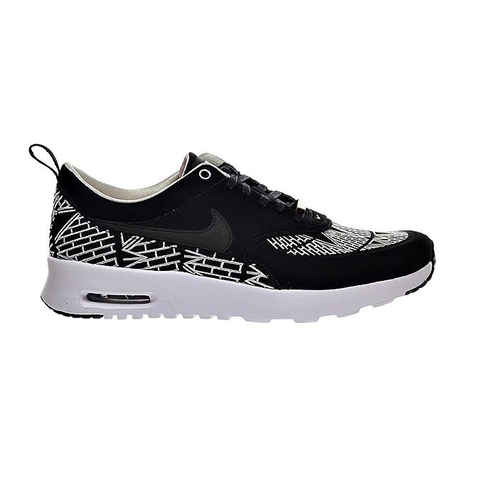the latest 16d3d 2683e Amazon.com   Nike Air Max Thea LOTC QS New York City Women s Shoes Black  White 847072-001 (7 B(M) US)   Fashion Sneakers