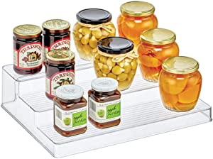 mDesign Plastic Kitchen Spice Bottle Rack Holder, Food Storage Organizer for Cabinet, Cupboard, Pantry, Shelf - Holds Spices, Mason Jars, Baking Supplies, Canned Food - 3 Level Storage - Clear