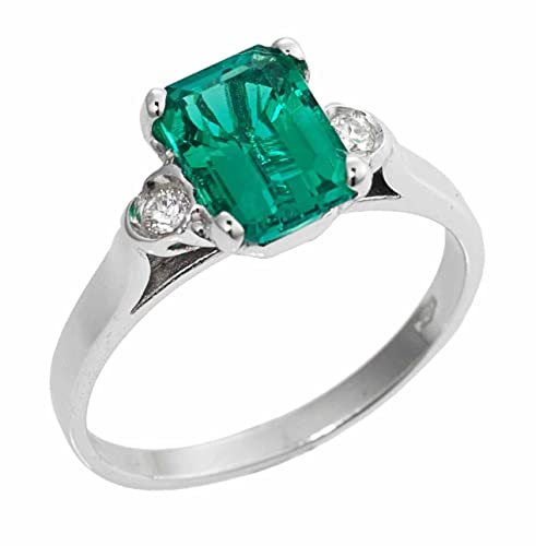 Anello in oro bianco 18kt con Smeraldo e diamanti