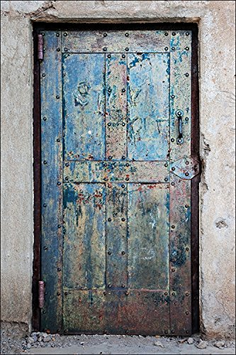 Photograph of rusty and colorful metal jail door found in the Rhyolite ghost town, Nevada. (Hotels Hospitals And Jails compare prices)