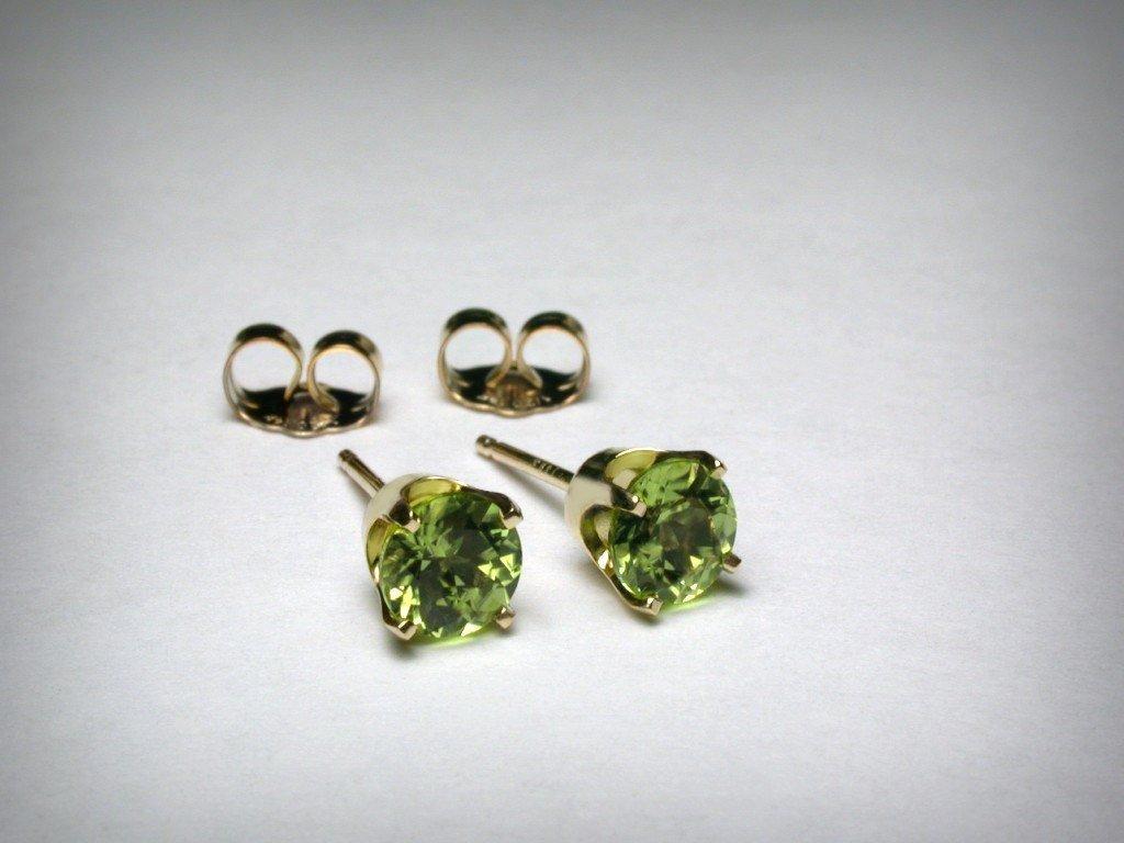 Genuine peridot stud earrings, in 14K yellow gold. AAA quality natural peridot from Arizona. 5mm.