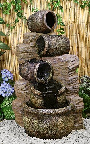 Fontana a cascata chierika   costituita da giare per l'olio ...