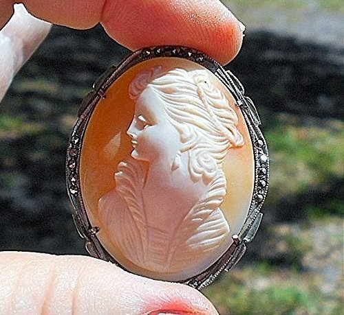 (Sterling Hand Carved Shell Cameo, Curvaceous Beauty with High Ruffled Open Collar Sparkling Marcasite Setting Brooch/Pendant from the 1940's.)