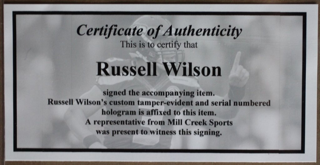 Russell Wilson Autographed Blue Seahawks Jersey Beautifully Matted
