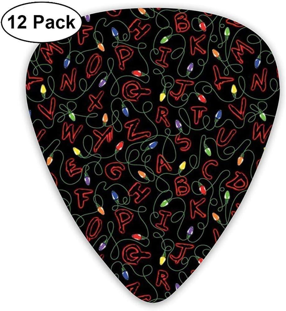 Stranger Things Guitar Picks 12 Pack - 3 tamaños diferentes incluye Thin, Medium & Heavy: Amazon.es: Instrumentos musicales