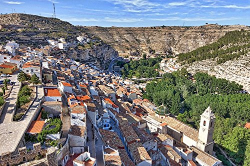 (Home Comforts Peel-n-Stick Poster of Alcala Del Jucar Hillside Village Mountain Valley Poster 24x16 Adhesive Sticker Poster Print)
